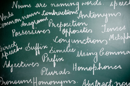 Image of English Grammar text handwritten on greenboard.