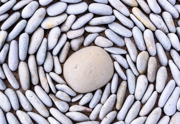 This is a photo of small pebbles around big stone