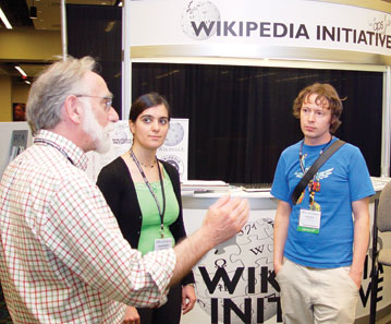 Robert Kraut (left) and Rosta Farzan (middle) from Carnegie Mellon University, along with Sage Ross (right) from the Wikimedia Foundation, discuss how the APS Wikipedia Initiative (APSWI) can help teachers incorporate Wikipedia into class assignments. Several demonstrations at the APS Convention showed faculty and students how to get involved in APSWI.