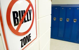 No bullying sign posted in a school hallway.