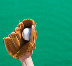 This is a photo of a baseball in a baseball mit.