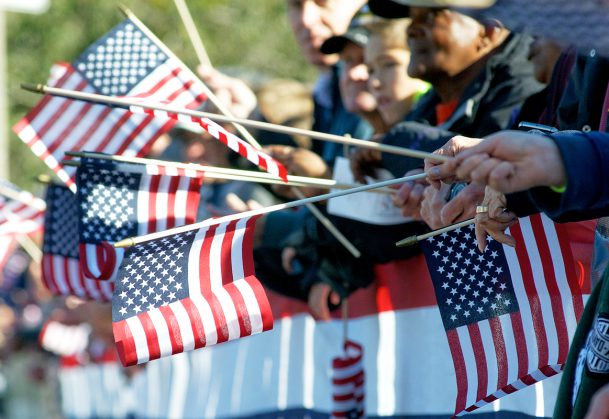 People holding American flags at the Philadelphia Veterans Day parade