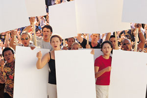 This is a photo of people holding blank signs at a protest.