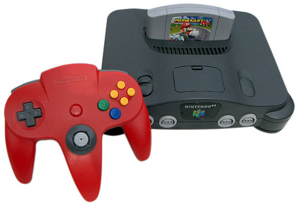 "This is a photo of a Nintendo 64 Game console and controller. Part of the appeal of video games is the opportunity to ""try on"" a better version of you."
