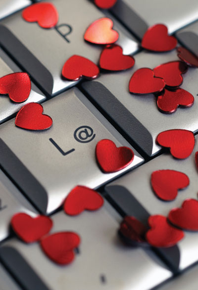 This is a photo of a keyboard covered with heart-shaped confetti.