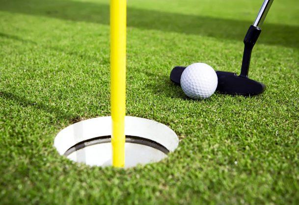 A golfer attempts to make a short putt