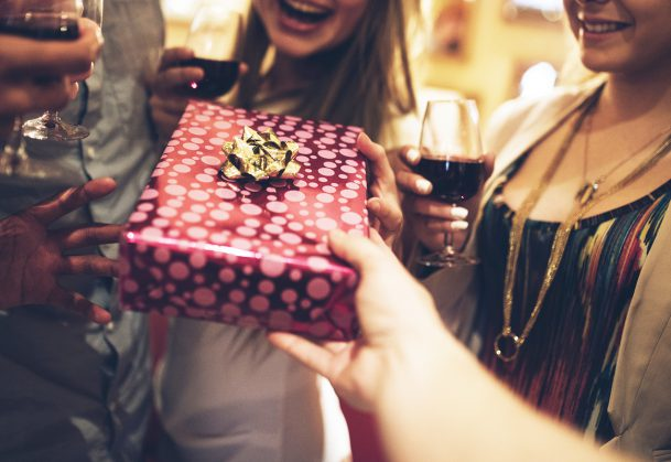 A group of friends exchanging gifts