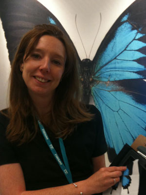 This is a photo of a woman holding butterfly-imprinted screen cleaner.