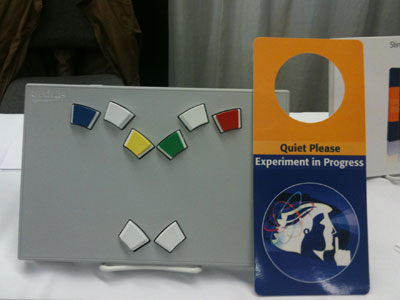 "This is a photo of a door hanger that reads, ""Quiet Please, Experiment in Progress."""