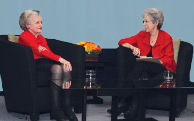 Legendary memory researcher Brenda Milner (left) tells social psychologist and writer Carol A. Tavris (right) how learning German at an early age influenced her research.