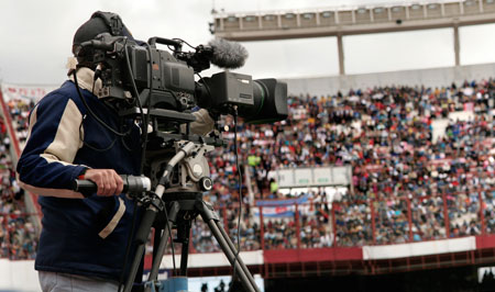 This is a photo of a reporter at a sports event. With three days left until the 2012 Olympics begin, the science behind the many complexities of sports and competition have been all over the news. Some recent psychological science highlights that have been making headlines.