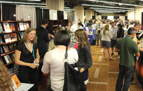 Attendees gather in a packed Exhibit Hall where 35 exhibitors were waiting to show them the latest in psychological science books, gear, and equipment.