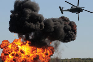 This is a photo of a helicopter and an explosion.