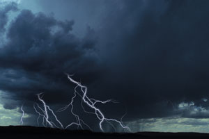 This is a photo of a large storm cloud and lightning.