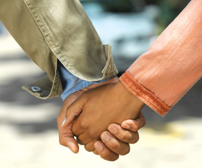 This is a photo of a couple holding hands. An obvious way to study romantic attachment is to simply ask people to report on their experiences.