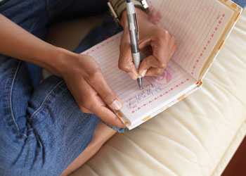 This is a photo of a person journaling.