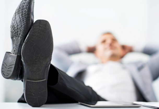 Businessman with his feet up on the desk