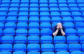 A soccer fan shows his disapointment as his team goes out of the cup.