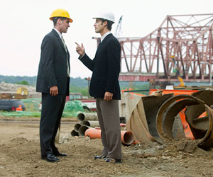 Two businessmen arguing on a construction site.