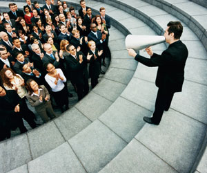 This is a photo of a CEO speaking to his employees through a megaphone.