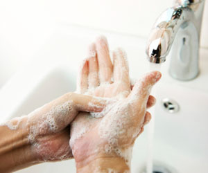 This is a photo of a person washing their hands with soap.