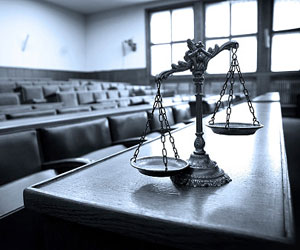 This is a photo of a set of scales in an empty courtroom.