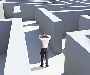This is a photo of a businessman in a maze.