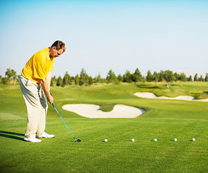 This is a photo of a man practicing his golf swing.