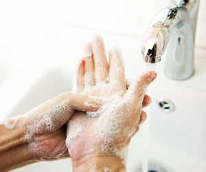 This is a photo of a person washing his hands.