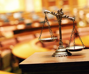 This is a photo of scales of justice in a courtroom.