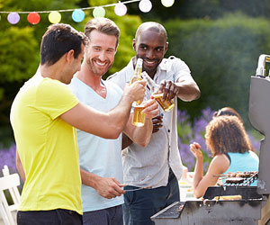 This is a photo of men drinking at a BBQ.