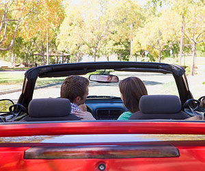 This is a photo of a couple in a convertible.