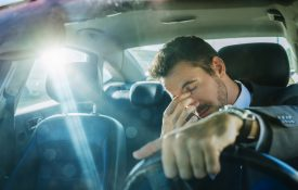 Exhausted businessman stuck in traffic