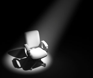 This is a photo of a chair under a spotlight.