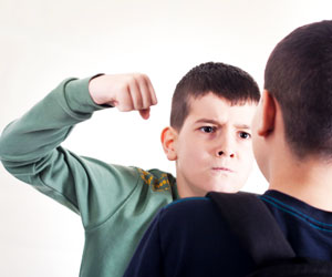 This is a photo of an aggressive-looking boy.