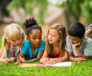 This is a photo of children reading together.