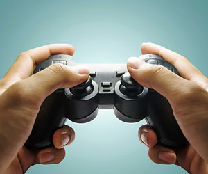 This is a photo of hands holding a video game controller.