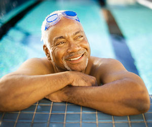 This is a photo of an older man in a swimming pool.