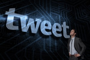 Tweet against futuristic black and blue background