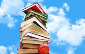 This is a photo of a stack of books against a blue sky.