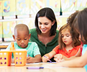 This is a photo of children coloring in daycare.
