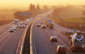 Traffic on highway with cars at sunrise