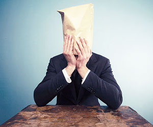 This is a photo of a businessman with a bag over his head.
