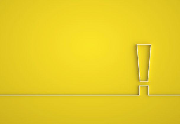 Hazard warning symbol in yellow background.