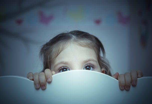 little girl is afraid of shadow