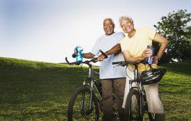Smiling senior couple with mountain bikes