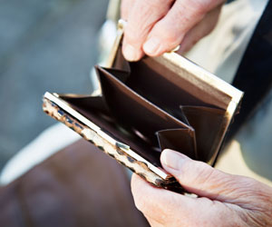 This is a photo of someone holding open an empty wallet.