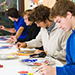 This is a photo of students painting in an art classroom.