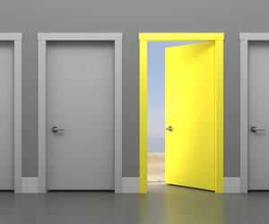 This is an illustration of an open yellow door amidst closed gray doors.