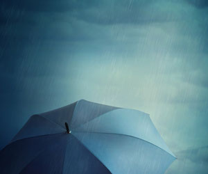 This is a photo of a person with an umbrella in a storm.